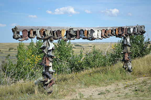 A collection of worn out boots at the entrance to the Great Sandhills of Saskatchewan, Canada