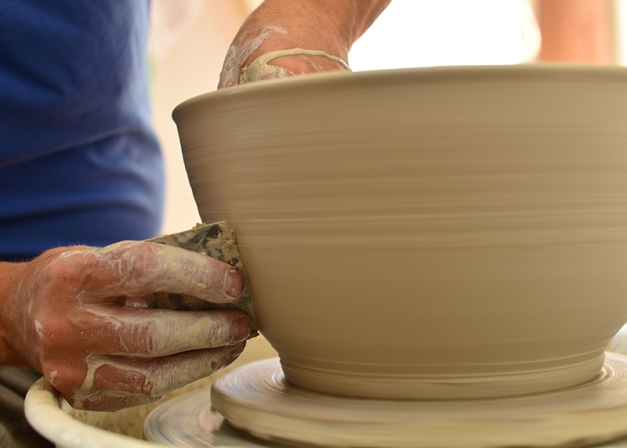 Moderating his movements, joy and pride shine through with each word. I focus on the creative act, consciously listen to his commentary, immersed in the meditative moment I barely breathe. The potter continues to guide the clay with his hands on assisted by a moist sponge.