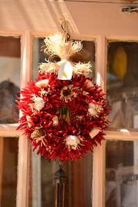 A welcoming door ornament, the ubiquitous chili wreath.