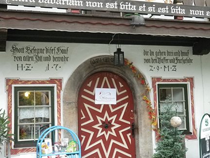 A close up of the entry: Carved and painted doors are everywhere. Farmhouses and businesses alike showcase fresco painting, inscriptions  about the building's history, it's inhabitants and the year the building was first erected.