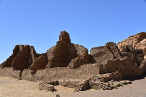 Pueblo Bonito's partial walls are in stark contrast to the deep blue cloudless sky.