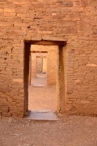 Inner living spaces, one room leading to another. The doorways are low and suggest the smaller stature of its original inhabitants.