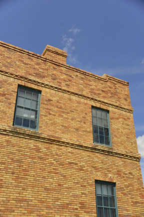 This building looks like it was recently erected with its clean lines and sturdy brick construction.