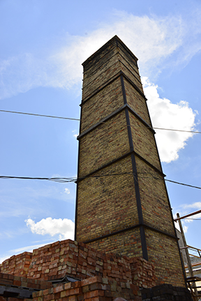 One of the tall chimneys reaching high into the sky, once a way to vent the extreme heat away from the work site - now a reminder of immense productivity and strong work ethic.