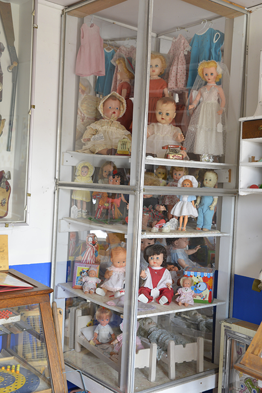 Dolls Safely Locked Away In This Display Cabinet