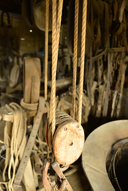 The saddlery - a treasure trove of ropes, leather, chains... what else can I find beside this old pulley?