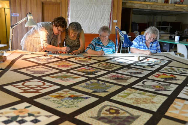 The quilting bee in progress