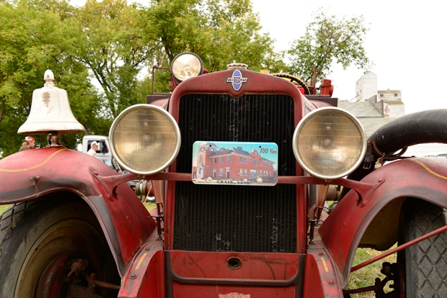 The old fire truck sports a commemorative plaque from the 100th birthday celebration in 2007.