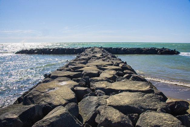 Breakwater at Fumicino Beach, Italy in the mid-afternoon sun.