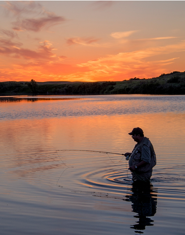 Serenity - lone fisherman in the afterglow of the Saskatchewan Sunset.