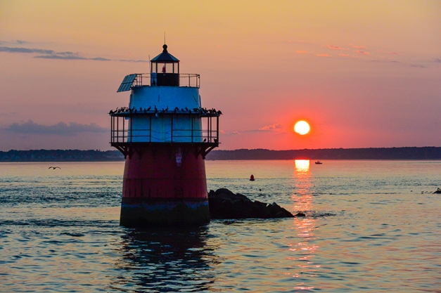 The light house in the harbor, a favorite hangout for the cormorants that also occupy a nearby rocky island.