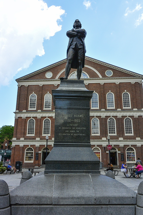 Faneuil Hall with the larger than life  Samuel Adams Statue - art and architecture to honor Bostonians who have shaped history.