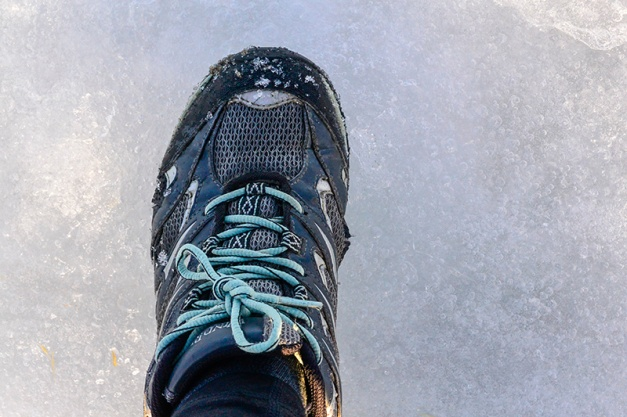 ...only to break through the thin layer of ice covering the crust below. Water was seeping through my runners immediately!