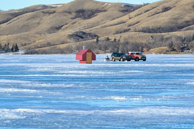 I zoomed in on some movement in the middle of the semi frozen lake and realized that ice fishermen are brave souls... this one had made his way by truck.